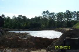 Mixing area for sediment/soil shown almost full.  Mixture will be moved to new staging area between large soil piles.