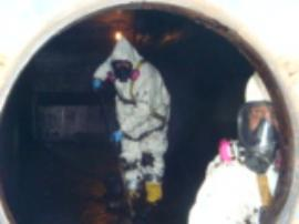 Kemron Techs cleaning out interior of frac tank during Level