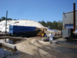 ERRS loading pad sludge near Tank #17  into lined roll-off.