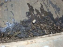 Sludge from concrete pad around Tank #17 scraped from concrete pad.