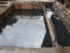 Anoter view of interior of sludge pit prior to pump-out.  Note heavy oil sheen.