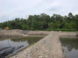 Rock wall bifurcating retention pond after ERRS reworked stone.
