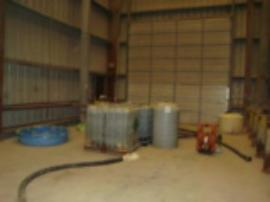 Drums of bulked liquid pumped from pit inside Bldg. #3.