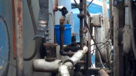 Old valve between Tanks 4 & 5 in soils processing area that leaked waste oil into containment area.  Valve is just above the blue pail.