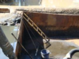 View of sludge pit near incinerator after removal of oil sludge and power washing.