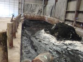 View of contaminated material in mixing pit in Building #3.