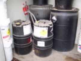 Containers of hydrogen peroxide (35%) stored with containers of powdered oxidizer.