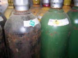 Cylinders of various compressed gases stored together.