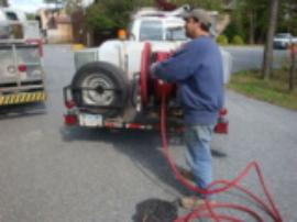 Roto-router tech at Site to remove blockage from sewer line to street.
