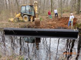 Initial Dam erected to stop flow on East side of I-40 W