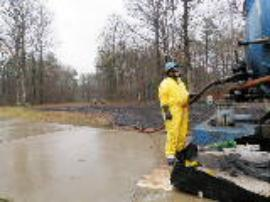 Vac truck puming oil at pipeline rupture location, west of residence at north end of Shadetreee Ln cul-de-sac<br />Date Taken: 3/30/2013<br />Category: Site Photo<br />Latitude: 34.963807<br />Longitude: -92.428653<br />Tags: