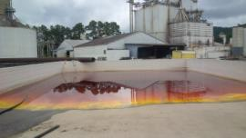 Spilled soybean oil in secondary containment