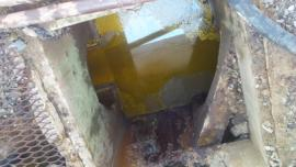 Storm Sewer filled with oil