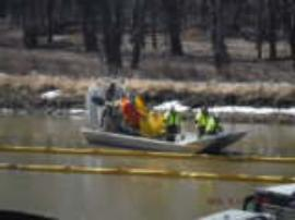 Containment boom maintenance and surface water sampling from air boats deployed in the Harris Slough of the Mississippi River<br />Date Taken: 3/14/2015<br />Category: Site Photo<br />Latitude: <br />Longitude: <br />Tags: