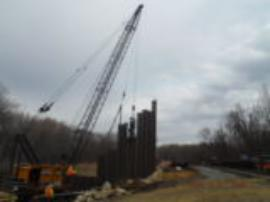 Last of the sheet piles being installed on the north side of the impact area <br />Date Taken: 3/19/2015<br />Category: Site Photo<br />Latitude: <br />Longitude: <br />Tags: