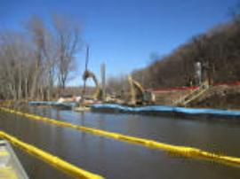 Sheet pile installation along the shoreline to isolate impacted area from potential inundation from rising river levels