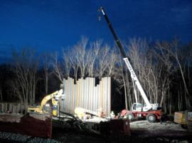 Two different sheet pile contractors have been working around the clock to install containment around the impacted area.<br />Date Taken: 3/17/2015<br />Category: Site Photo<br />Latitude: <br />Longitude: <br />Tags: