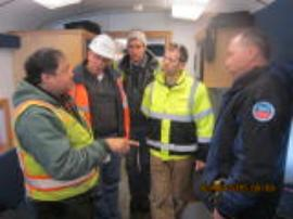 OSCs Mendoza & Faryan discussing response strategies with BNSF Railway contractors