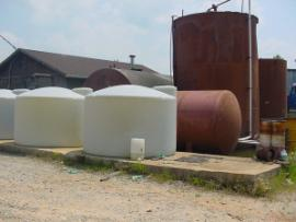 In this picture, the horizontal tank is the back of the pressure vessel and the taller storage tank is a water tank.