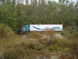 Tractor trailer sitting in a wetland area after veering off coarse.  The accident site was off the east bound lane of I-20 at mile marker 16.
