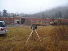 View of air monitoring unit on-site during demo activities.